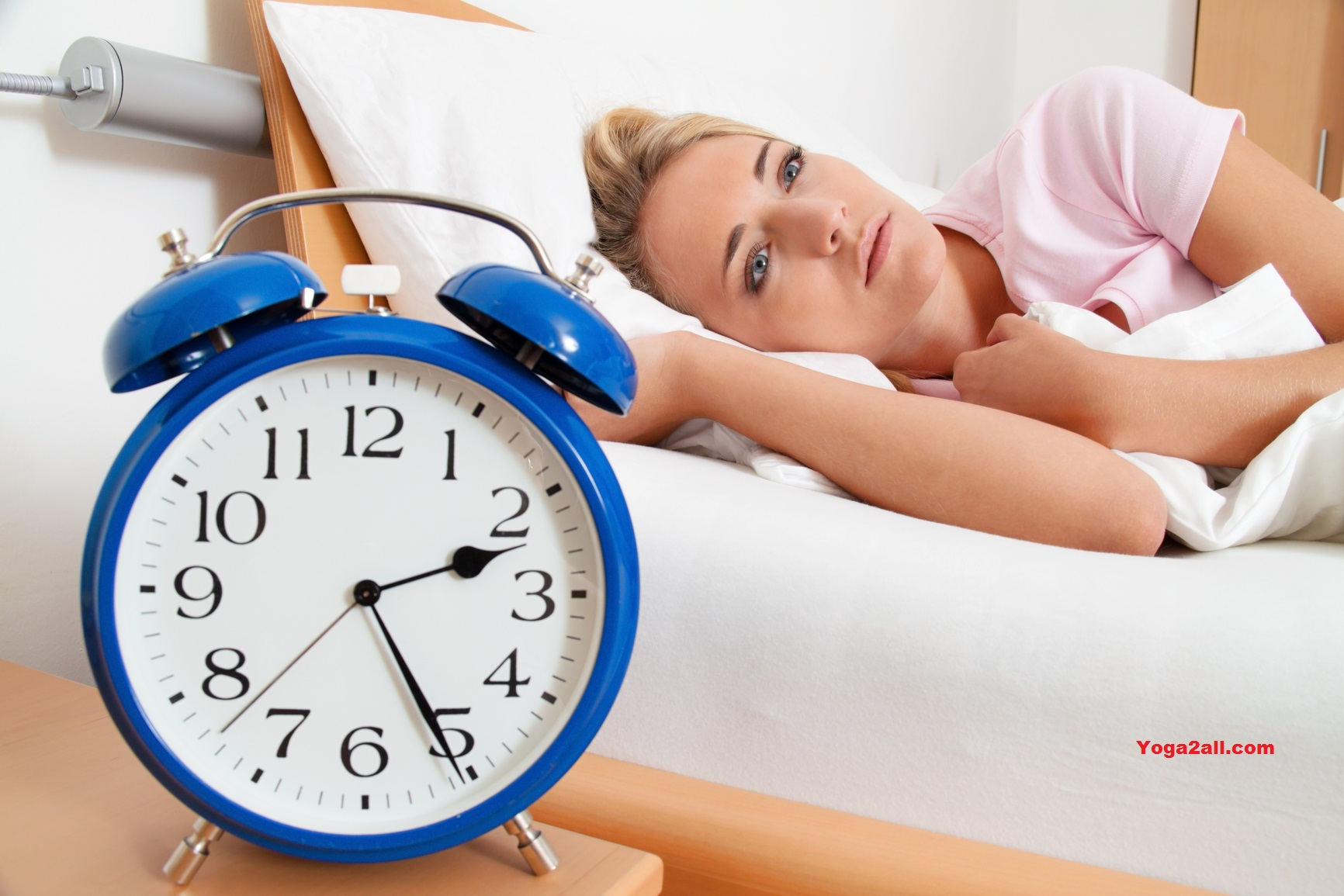 insomnia with clock in the night. woman can not sleep.